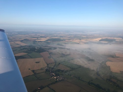 Breakfast and aerial sightseeing run